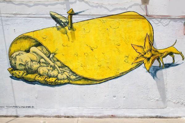 Уличный стрит-арт, стилизованный под фрески